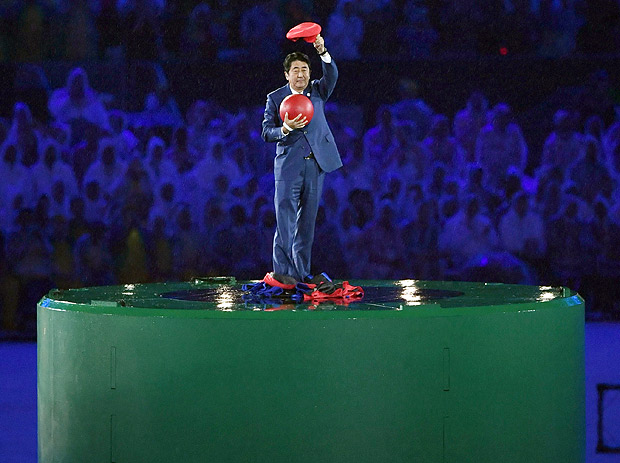 apanese Prime Minister Shinzo Abe poses just after removing the costume of the Nintendo game character Super Mario as he makes an appearance during the closing ceremony at the 2016 Summer Olympics in Rio de Janeiro, Brazil, Sunday, Aug. 21, 2016. Abe's brief but show-stopping appearance as Super Mario offered a tantalizing glimpse at Tokyo's plans for the 2020 games. (Yu Nakajima/Kyodo News via AP) ORG XMIT: TKTT804