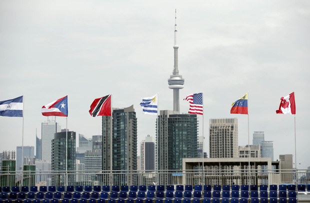 Jul 9, 2015; Toronto, Ontario, Canada; A general view of the CN Tower and Toronto skyline behind the grandstand of the Beach Volleyball Centre in preparation for the 2015 Pan Am Games. Mandatory Credit: Rob Schumacher-USA TODAY Sports ORG XMIT: USATSI-230534