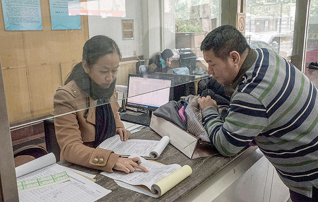 Mr. Ji dropping off clothes to be tested at a product quality inspection center in Jinan. Last year, China's courts handled about 120,000 intellectual property cases, up 9 percent from 2014, according to official media.