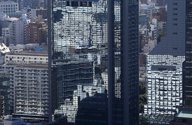 Office buildings are seen in Tokyo July 21, 2015. Two in five Japanese firms plan to boost capital spending this business year, and more than a third of those say it is because of rising demand, a Reuters poll showed, pointing to a pickup in confidence about the economy. Picture taken July 21, 2015. REUTERS/Toru Hanai ORG XMIT: TOK513 ---------- Fukoku Mutual Life Insurance believes it will increase productivity by 30% Photograph: Toru Hanai/REUTERS