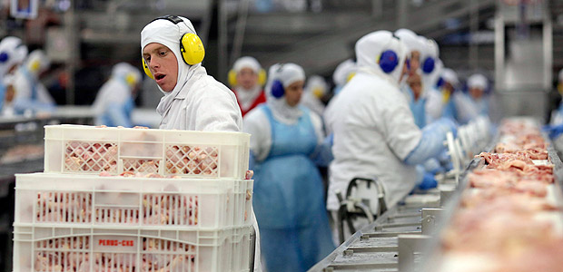 Workers prep poultry at the meatpacking company JBS, in Lapa, in the Brazilian state of Parana, Tuesday, March 21, 2017. Brazil