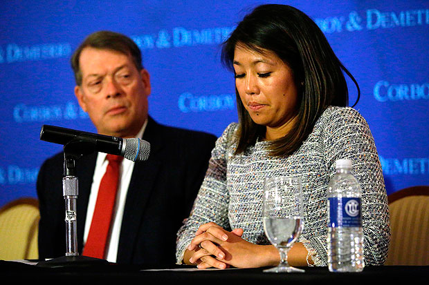 Crystal Dao Pepper (R), daughter of Dr. David Dao, pauses as she speaks about her father as she sits with her attorney Stephen Golan during a news conference on April 13, 2017 in Chicago, Illinois. Attorneys Thomas Demetrio and Golan are representing Dr. Dao after airport police officers physically removed him from his United Airlines seat and dragged him off the airplane at O'Hare International Airport during his flight from Chicago to Louisville, Kentucky, on April 9, 2017. / AFP PHOTO / Joshua LOTT ORG XMIT: JL567