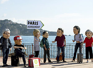 Oxfam activists wearing masks of the leaders of the G7 summit; from left, Italian Premier Paolo Gentiloni, US President Donald Trump, German Chancellor Angela Merkel, Japanese Prime Minister Shinzo Abe, French President Emmanuel Macron, Canadian Prime Minister Justin Trudeau, and British Prime Minister Theresa May stage a demonstration in Giardini Naxos, near the venue of the G7 summit in the Sicilian town of Taormina, southern Italy, Friday, May 26, 2017. Climate change promises to be the most problematic issue for this summit after Trump's decision to review U.S. policies related to the Paris Agreement on fighting global warming. (Angelo Carconi/ANSA via AP) ORG XMIT: ALT104