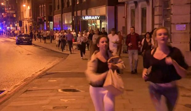 In this Saturday, June 3, 2017, image made from a video, people run from the scene an attack in London. The Borough neighborhood in London offered safety and a place to sleep for hundreds of people amid the chaos of Saturday night's attack in the heart of the city. (Sky news via AP) ORG XMIT: NYJK102