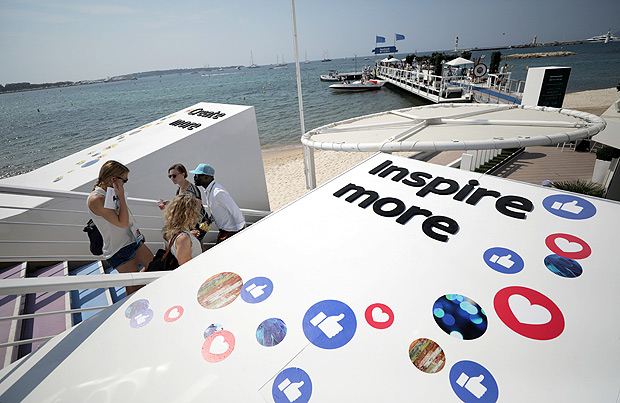 Logos of the social network Facebook are seen on a beach during the Cannes Lions in Cannes, France, June 21, 2017. REUTERS/Eric Gaillard ORG XMIT: NIC25