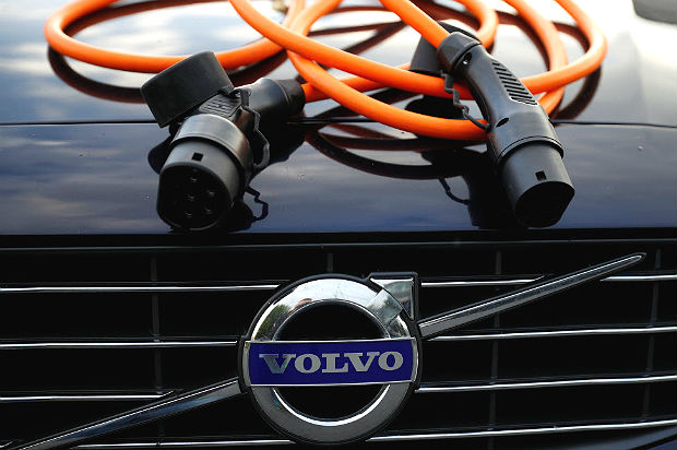 An electric vehicle charging cable is seen on the bonnet of a Volvo hybrid car in this picture illustration taken July 6, 2017. REUTERS/Phil Noble/Illustration ORG XMIT: PNN01