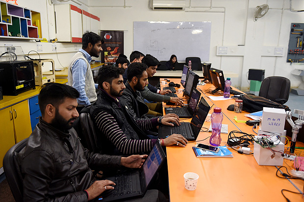 In this photograph taken on February 6, 2017, employees of Indian company Nuts and Boltz work in their office in New Delhi. Since coming to power in 2014, Narendra Modi has been looking to overhaul India's image as an awkward country in which to do business and instead emulate China by becoming a global manufacturing hub. While much of the focus has been on travails of foreign firms, local entrepreneurs who should be the poster boys of Indian manufacturing are also struggling. / AFP PHOTO / Money SHARMA / TO GO WITH India-manufacturing-economy-technology, FOCUS by Megha BAHREE