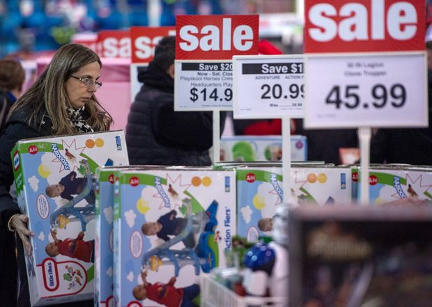 A woman shops for a bargains during the Thanksgiving holiday on November 28, 2013, at the Toys-R-Us store in Fairfax, Virginia. More than a dozen US retailers opened their doors to shoppers one day ahead of the famed-Black Friday shopping day. AFP PHOTO/Paul J. Richards ORG XMIT: PJR39919
