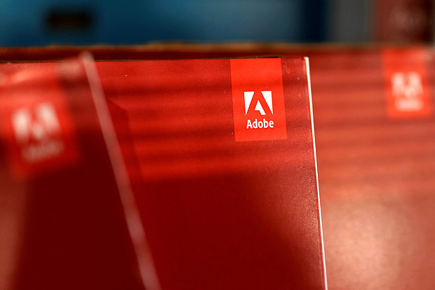 FILE PHOTO: An Adobe Systems Inc software box is seen in Los Angeles, California, U.S., March 13, 2017. REUTERS/Lucy Nicholson/File Photo GLOBAL BUSINESS WEEK AHEAD - SEARCH GLOBAL BUSINESS 19 JUN FOR ALL IMAGES ORG XMIT: BWA307