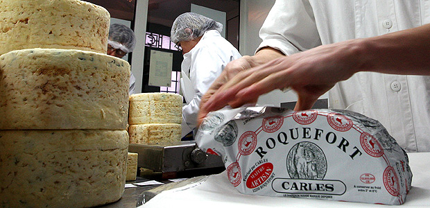 FILE - In this Jan. 22, 2009, file photo, French family company Carles employees work at Carles Roquefort cheese factory in Roquefort, southwestern France. Japan and the European Union are hoping to reach an economic partnership agreement within days, countering the backlash against free trade by U.S. President Donald Trump. Their trade and agriculture ministers are due to meet in Tokyo on Friday, June 30, 2017, trying to forge a deal before the Group of 20 industrial nations meets next week in Germany. Local reports said a main point of disagreement was Japan's up to 40 percent tariffs on imported cheese. (AP Photo/Bob Edme, File) ORG XMIT: TKH101