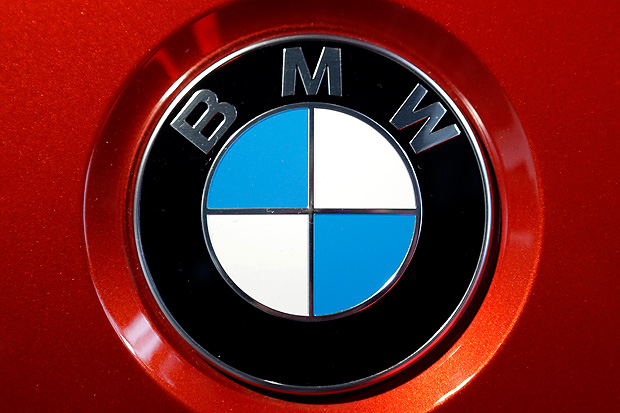 FILE - In this March 21, 2017 file photo, the logo of German car manufacturer BMW is photographed at a BMW M6 Coupe car during the earnings press conference in Munich, Germany. German luxury automaker BMW said Thursday Aug. 3, 2017 net profit rose 14 percent in the second quarter as earnings were boosted by the new version of the 5-Series sedan. (AP Photo/Matthias Schrader,file) ORG XMIT: MBER115