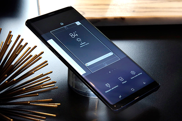 This Aug. 16, 2017, photo, shows a Samsung Galaxy Note 8 on display, in New York. Samsung is trying to move past last year's explosive Galaxy Note 7 launch with a successor sporting a dual-lens camera, animated messages, expanded note-taking and lower battery capacity. The Galaxy Note 8 will go on sale Sept. 15, 2017. (AP Photo/Richard Drew) ORG XMIT: NYRD203