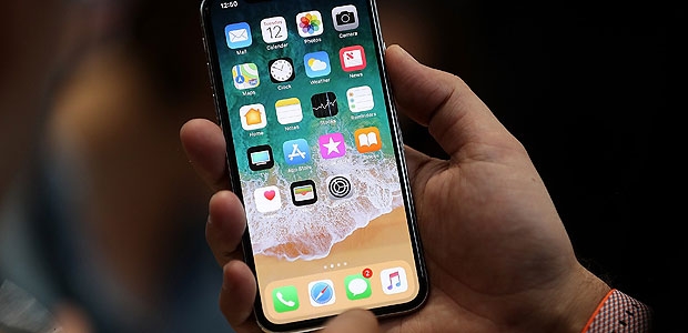 CUPERTINO, CA - SEPTEMBER 12: The new iPhone X is displayed during an Apple special event at the Steve Jobs Theatre on the Apple Park campus on September 12, 2017 in Cupertino, California. Apple held their first special event at the new Apple Park campus where they announced the new iPhone 8, iPhone X and the Apple Watch Series 3. Justin Sullivan/Getty Images/AFP == FOR NEWSPAPERS, INTERNET, TELCOS & TELEVISION USE ONLY ==