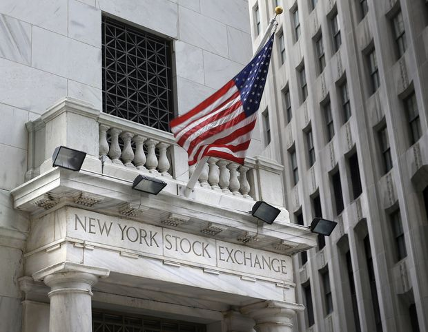 FILE - This Monday, Aug. 24, 2015, file photo shows the New York Stock Exchange. Stocks are opening moderately higher on Wall Street, Thursday, Dec. 21, 2017, led by gains in banks and technology companies. (AP Photo/Seth Wenig, File) ORG XMIT: NYBZ444