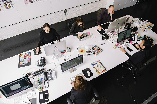 Employees at Design Army's space in Washington, Nov. 9, 2017. The company creates visual branding for a wide range of clients and is now seeing a period of growth. (Andrew Mangum/The New York Times)