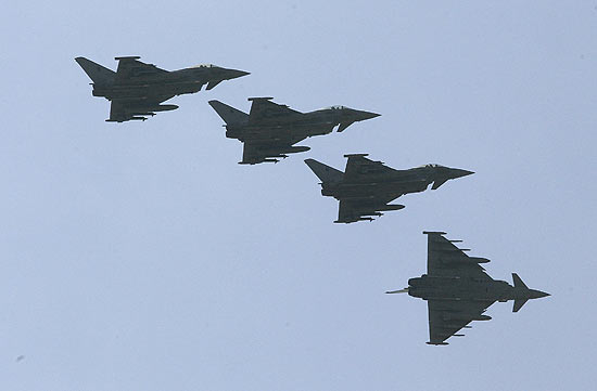 """ORG XMIT: AMP304 Four Italian Air Force Eurofighter EF-2000 Typhoon fly over the Birgi NATO Airbase in Trapani on the southern Italian island of Sicily March 23, 2011. Western governments inched closer to a deal on Wednesday over who should lead military operations against Muammar Gaddafi's forces in Libya, with France saying NATO will have only a """" technical role"""". REUTERS/Tony Gentile (ITALY - Tags: TRANSPORT MILITARY POLITICS CONFLICT)"""