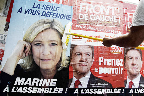 ORG XMIT: PR14 A Parti de Gauche political party activist pastes posters on a wall in support for Jean-Luc Melenchon of France's Parti de Gauche political party for the upcoming legislative elections, in Henin-Beaumont May 29, 2012. REUTERS/Pascal Rossignol (FRANCE - Tags: POLITICS)