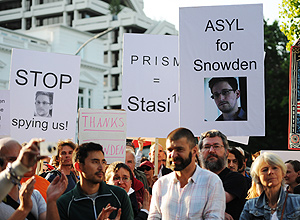 Demonstrators with posters of U.S intelligence contractor Edward Snowden protest against US National Security Agenca (NSA) surveillance program, in front of the US consulate in Hamburg, Germany.