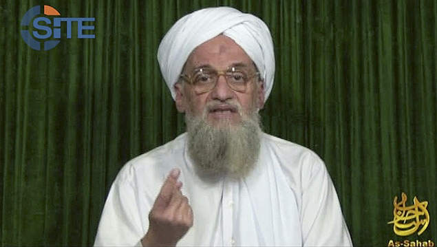 """FILE - This file image from video the AP obtained Feb. 12, 2012, from the SITE Intel Group, an American private terrorist threat analysis company, authenticated based on details in it, shows al-Qaida's leader Ayman al-Zawahri in a web posting by al-Qaida's media arm, as-Sahab, calling on Muslims across the Arab world and beyond to support rebels in Syria who are seeking to overthrow President Bashar Assad. Al-Zawahri spoke in a 15-minute Internet audio message posted late Friday, Aug. 2, 2013, his second this week. He condemned the overthrow of Egypt's ousted President Mohammed Morsi, but also blamed Morsi for trying to """"satisfy America"""" by abandoning jihad. (AP Photo/SITE Intel Group, File) ORG XMIT: CAI101"""