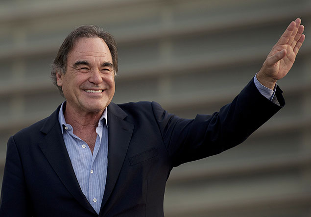 U.S. film director, Oliver Stone waves during a photocall for the 61st San Sebastian Film Festival, in San Sebastian, northern Spain, Tuesday, Sept. 24, 2013. (AP Photo/Alvaro Barrientos) ORG XMIT: AB110