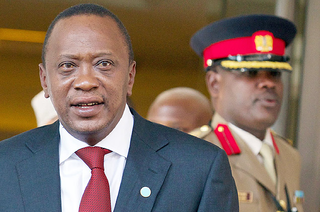 (FILES) -- A file photo taken on May 7, 2013 shows Kenyan President Uhuru Kenyatta (L) leaving a hotel in central London, as he prepares to attend a conference on Somalia. The International Criminal Court's chief prosecutor on December 5, 2014 dropped her crimes against humanities case against Kenyan President Uhuru Kenyatta, saying she did not have enough evidence to take him to trial. AFP PHOTO / ANDREW COWIE ORG XMIT: 067