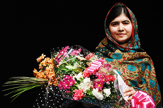 "(FILES) -- A file photo taken on October 10, 2014 shows Pakistani rights activist Malala Yousafzai posing for a photograph after addressing the media in Birmingham, central England. Nobel peace laureate Malala Yousafzai on April 13, 2015 criticised Nigerian and world leaders for failing to help free 219 schoolgirls kidnapped a year ago by Boko Haram militants. ""In my opinion, Nigerian leaders and the international community have not done enough to help you,"" she said in a letter to the teenagers on the eve of the first anniversary of their abduction. AFP PHOTO / OLI SCARFF ORG XMIT: JR080"