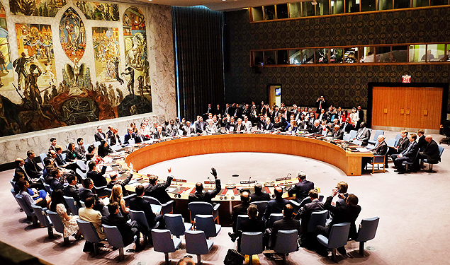 "United Nations Security Council members vote on the Iran resolution at the UN headquarters in New York on July 20, 2015. The UN Security Council on Monday unanimously adopted a resolution that will clear a path for international sanctions crippling Iran's economy to be lifted. Representatives of all 15 countries on the council voted by raising their hands. ""The draft resolution has been adopted unanimously,"" New Zealand ambassador Gerard van Bohemen, whose country holds the current presidency of the Security Council. AFP PHOTO/JEWEL SAMAD ORG XMIT: JS1018"