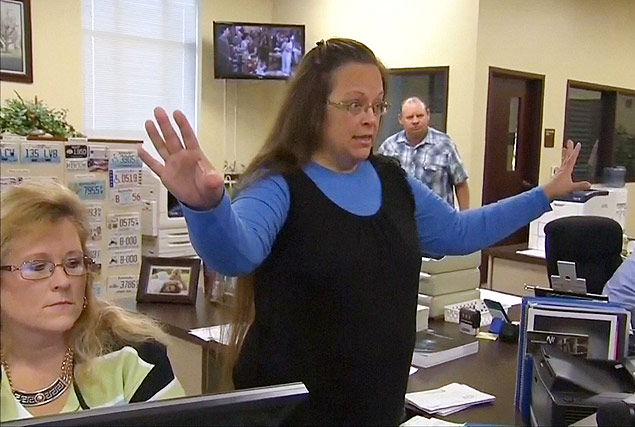 """Rowan County Clerk Kim Davis gestures as she refuses to issue marriage licenses to a same-sex couple in Morehead, Kentucky September 1, 2015, in a still image from video provided by WLEX. Davis, defying a new U.S. Supreme Court decision and citing """"God's authority,"""" rejected requests for marriage licenses from same-sex couples on Tuesday in a deepening legal standoff now two months old. REUTERS/WLEX/LEX18.com FOR EDITORIAL USE ONLY. NOT FOR SALE FOR MARKETING OR ADVERTISING CAMPAIGNS ORG XMIT: TOR505"""