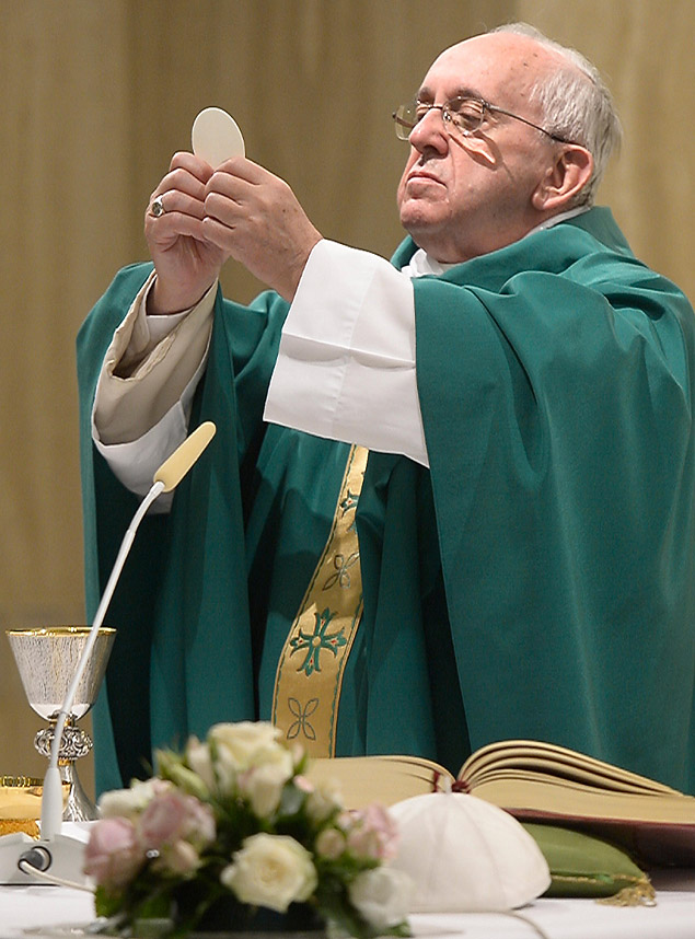 "This handout picture released by the Vatican press office (Osservatore Romano) shows Pope Francis holding up sacramental bread as he celebrates mass in Santa Marta at the Vatican on September 1, 2015. AFP PHOTO / OSSERVATORE ROMANO -- RESTRICTED TO EDITORIAL USE - MANDATORY CREDIT ""AFP PHOTO / OSSERVATORE ROMANO"" - NO MARKETING NO ADVERTISING CAMPAIGNS - DISTRIBUTED AS A SERVICE TO CLIENTS -- ORG XMIT: APZ746"