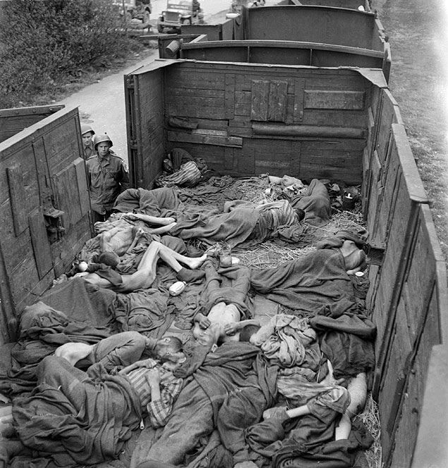 FILES - A picture taken at the end of May 1945 shows prisoner's dead bodies in a train as seen by US soldiers near Dachau concentration camp after the US army liberated the camp. American trucks rolled into Dachau, northwest of Munich, on April 29, 1945 to discover the unspeakable horror that had led to more than 41,000 people being killed or having starved or died of disease. German Chancellor Angela Merkel will join elderly survivors of the former Nazi concentration camp at Dachau on May 3, 2015 for a solemn ceremony to mark 70 years since its liberation by US forces. AFP PHOTO / ERIC SCHWAB ORG XMIT: DAC22