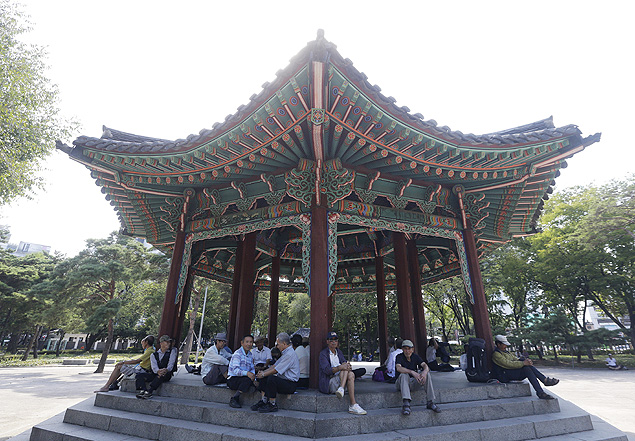 In this Sept. 15, 2015 photo, elderly people rest at Tapgol park in Seoul, South Korea. The park, mostly a place for relaxation for elderly residents in Seoul, had also been a site where elderly prostitutes solicit customers for sex in nearby motels. After widespread police crackdown this spring, many elderly prostitutes have disappeared in Seoul but some still operate near a plaza in front of the Piccadilly theater, which is about 10 minutes' walk from Tapgol Park. (AP Photo/Ahn Young-joon) ORG XMIT: XSEL104