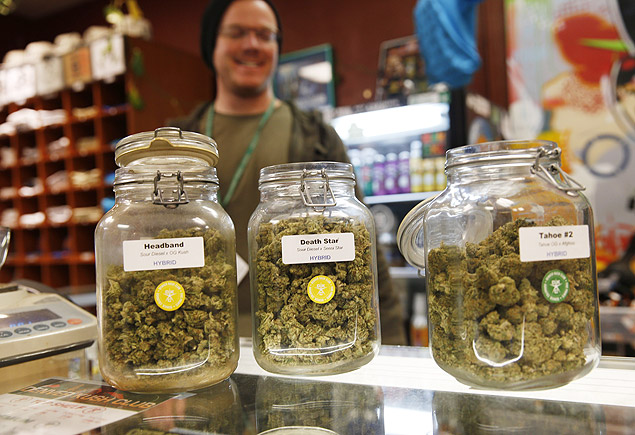 Jars of marijuana buds sit on the counter at the Denver Kush Club early Friday, Nov. 27, 2015, in north Denver. More than two dozen customers took advantage of a new Colorado holiday tradition of marijuana shops drawing customers with discounted weed and holiday gift sets. (AP Photo/David Zalubowski) ORG XMIT: CODZ103