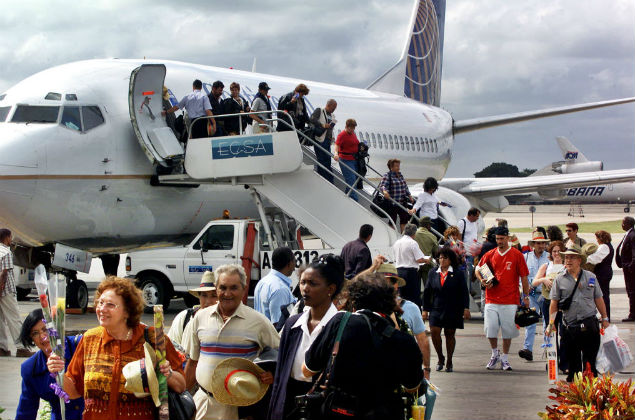 . 1, 2001, file photo, the first passengers of the first flight of Continental Airlines from Miami Florida, arrives at the Jose Marti Airport of Havana, Cuba. The United States and Cuba have reached an understanding on restoring regularly scheduled commercial flights, Cuban and American officials said Wednesday, Dec. 16, 2016 on the eve of the anniversary of detente between the Cold War foes. (AP Photo/Jose Goitia, File) ORG XMIT: XLAT111