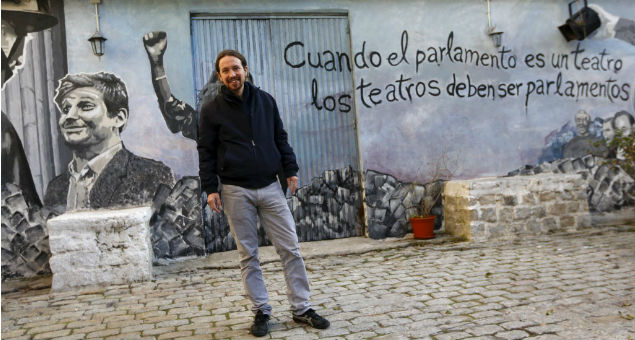 """party leader Pablo Iglesias poses before watching a film on the eve of Spain's general election in Madrid, Spain, December 19, 2015. The words on the wall reads in Spanish, """"When the Parliament is a theatre, theatres must become Parliaments"""". REUTERS/Sergio Perez EDITORIAL USE ONLY. NO RESALES. NO ARCHIVE ORG XMIT: SPS06"""