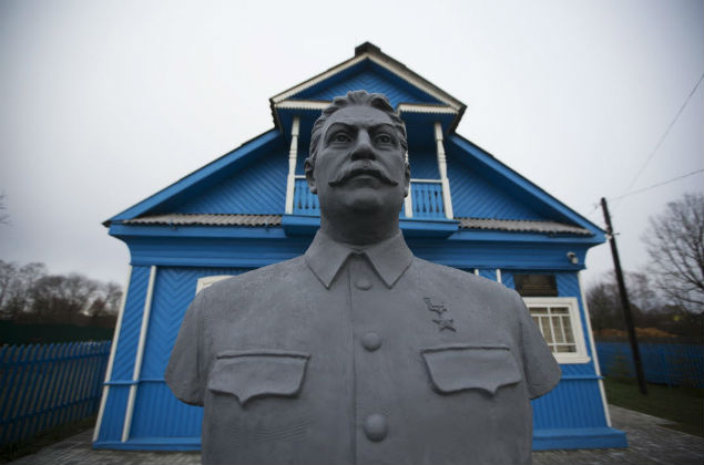 Dec. 9, 2015 photo a bust of Soviet leader Josef Stalin stands on the front lawn of a house-turned-museum in the village of Khoroshevo, west of Moscow, Russia. The Stalin museum was opened this year in this small village where the Soviet leader is said to have stayed the night on his only visit to the front during World War II. (AP Photo/Pavel Golovkin) ORG XMIT: MOSB502