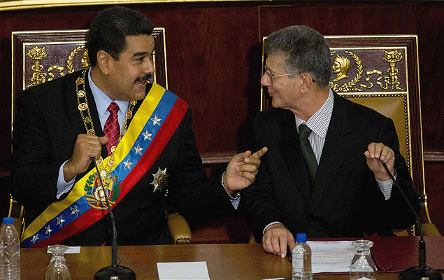 Venezuela's President Nicolas Maduro, left, speaks with President of the National Assembly Henry Ramos Allup, prior to delivering his annual state of the nation report in Caracas, Venezuela, Friday, Jan. 15, 2016. Ahead of a surprise dire economic data release, Maduro said he would declare an economic emergency giving him 60 days to unilaterally enact sweeping reforms. The decree will be debated in the newly-seated opposition congress next week. (AP Photo/Fernando Llano) ORG XMIT: XFLL102