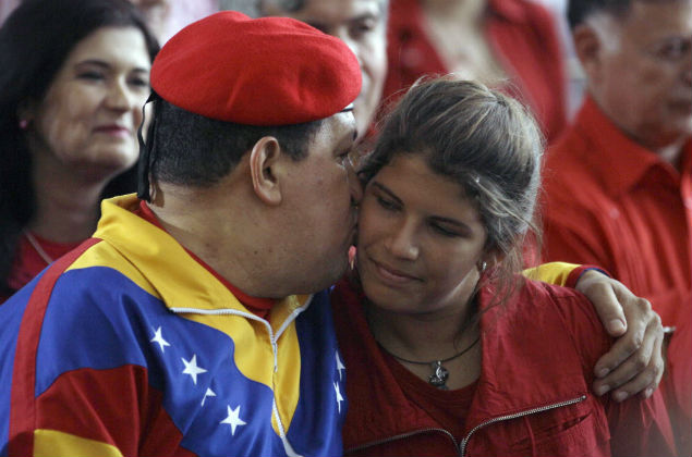 Venezuela's President Hugo Chavez, left, kisses his daughter Rosines during a ceremony to register his candidacy for the presidency at the National Elections Council, CNE, in Caracas, Venezuela, Monday, June 11, 2012. Chavez rallied thousands of his supporters Monday, wearing his signature red beret and singing a folk song as he formalized his presidential candidacy and launched his re-election bid. (AP Photo/Fernando Llano) P�gina anterior 1 de 7 Seguinte