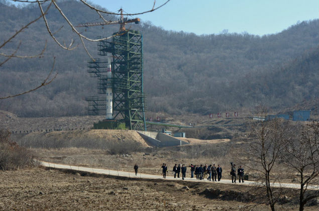 This file photo taken on April 8, 2012 shows North Korean officials and foreign journalists leaving the launch pad after a visit to see the rocket Unha-3 in Tangachai -ri space center. North Korea launched a long-range rocket on February 7, 2016, violating UN resolutions and doubling down against an international community already determined to punish Pyongyang for a nuclear test last month. AFP PHOTO / FILES / Pedro UGARTE ORG XMIT: PUG066