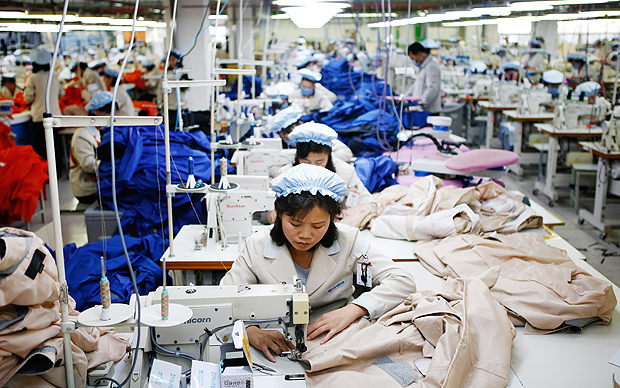 (FILES) This file photo taken on December 19, 2013 shows North Korean employees working at a factory of a South Korean-owned company at the Joint Industrial Park in Kaesong, just a few hundred metres (yards) north of the Demilitarized Zone (DMZ) which separates the two Koreas. South Korea said on February 10, 2016 it would suspend operations at the Kaesong joint industrial complex in North Korea to punish Pyongyang for its latest rocket launch and nuclear test. AFP PHOTO / FILES ORG XMIT: SEO209