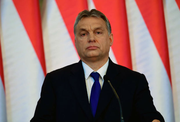 """Hungarian Prime Minister Viktor Orban addresses a press conference at the Delegation Hall of the parliament building in Budapest on February 24, 2016. Hungary will hold a referendum on whether to accept mandatory EU quotas for migrants, Prime Minister Viktor Orban said, protesting that Brussels has no right to """"redraw Europe's cultural and religious identity."""" / AFP / ATTILA KISBENEDEK ORG XMIT: ATT12041"""
