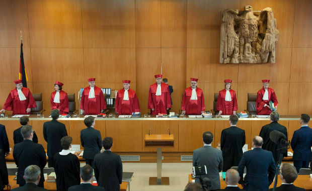 Judges of the second senate at the German Federal Constitutional Court (Bundesverfassungsgericht) in Karlsruhe, southern Germany, (L-R) Ulrich Maidowski, Sibylle Kessal-Wulf, Peter M Huber, Peter Mueller, Andreas Vo�kuhle (chairman), Herbert Landau, Monika Hermanns and Doris Koenig arrive to open a hearing on a possible ban of the far-right NPD party at the German Federal Constitutional Court (Bundesverfassungsgericht) in Karlsruhe, southern Germany, on March 1, 2016. Germany's highest court will hear a landmark request to ban the neo-Nazi fringe NPD party, more than a decade after a first attempt failed. The case before the Federal Constitutional Court will argue that the far-right and anti-immigrant National Democratic Party (NPD) spells a threat to the country's democratic order. / AFP / DPA / Marijan Murat / Germany OUT ORG XMIT: ber000