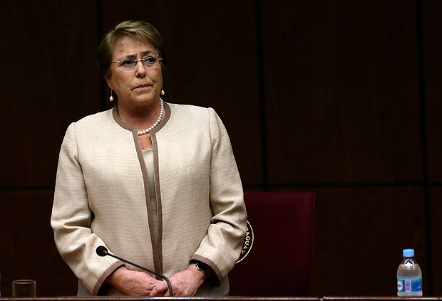 In this Aug. 21, 2015 photo, Chile's President Michelle Bachelet attends a congressional session, during her official visit, in Asuncion, Paraguay. Bachelet was once among Latin America's most popular leaders. Although she still enjoys a majority in Congress, many reforms she campaigned for seem doubtful amid behavior some view as erratic. (AP Photo/Jorge Saenz) ORG XMIT: ASU302