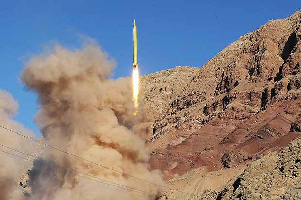 A long-range Qadr ballistic missile is launched in the Alborz mountain range in northern Iran on March 9, 2016. Iran said its armed forces had fired two more ballistic missiles as it continued tests in defiance of US warnings. / AFP / TASNIM NEWS / MAHMMOD HOUSSEINI ORG XMIT: AK897