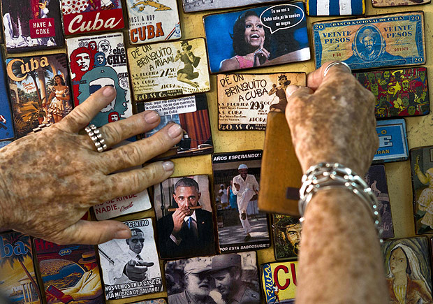 """The artisan called """"Buby"""" displays several refrigerator magnets showing images of U.S. President Barack Obama and First lady Michelle Obama, for sale in a tourist shop in Havana, Cuba, Monday, March 14, 2016. President Barack Obama is traveling to Cuba on March 20. (AP Photo/Ramon Espinosa) ORG XMIT: XRE102"""
