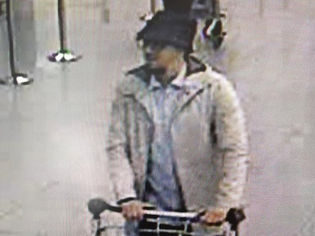"A handout image released on March 22, 2016 by the Belgian Federal Police on demand of the Federal prosecutor shows a screengrab of the airport CCTV camera showing a suspect of this morning's attacks at Brussels Airport, in Zaventem, pushing a trolly with suitcases. A series of explosions claimed by the Islamic State group ripped through Brussels airport and a metro train today, killing around 35 people in the latest attacks to bring bloody carnage to the heart of Europe. / AFP PHOTO / BELGIAN FEDERAL POLICE / HO / - Belgium OUT / RESTRICTED TO EDITORIAL USE - MANDATORY CREDIT ""AFP PHOTO / BELGIAN FEDERAL POLICE"" - NO MARKETING NO ADVERTISING CAMPAIGNS - DISTRIBUTED AS A SERVICE TO CLIENTS"
