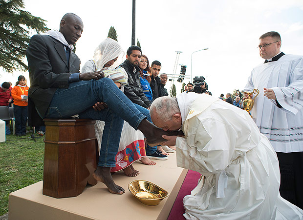 Pope Francis kisses the foot of a man during the foot-washing ritual at the Castelnuovo di Porto refugees center, some 30km (18, 6 miles) from Rome, Thursday, March 24, 2016. The pontiff washed and kissed the feet of Muslim, Orthodox, Hindu and Catholic refugees Thursday, declaring them children of the same God, in a gesture of welcome and brotherhood at a time when anti-Muslim and anti-immigrant sentiment has spiked following the Brussels attacks. (L'Osservatore Romano/Pool Photo via AP) ORG XMIT: OSS101