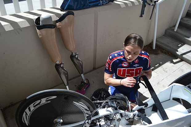 In this April 12, 2016 photo, Paralympian Oksana Masters prepares her hand-cycle during training at the Olympic Training Center, in Colorado Springs, Colo. Masters was adopted out of a Ukrainian orphanage by an American woman nearly two decades ago. The malnourished Masters had birth defects believed to be from the aftermath of Chernobyl and on the 30th anniversary of world's worst nuclear accident, Masters can't help but think about how far she's traveled. (AP Photo/P. Solomon Banda) ORG XMIT: COBL602