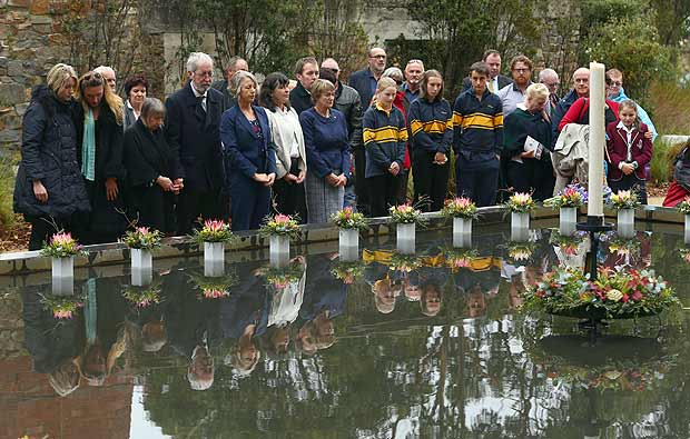 Family and community members lay 35 floral tributes in the Memorial Pool to remember the victims during the 20th anniversary commemoration service of the Port Arthur massacre, in Port Arthur, Australia April 28, 2016. AAP/Robert Cianflone/via REUTERS ATTENTION EDITORS - THIS PICTURE WAS PROVIDED BY A THIRD PARTY. EDITORIAL USE ONLY. NO RESALES. NO ARCHIVE.�AUSTRALIA OUT. NEW ZEALAND OUT.? ORG XMIT: SYD10