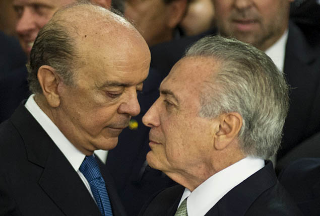 "Brazilian acting president Michel Temer (R) speaks with the new Foreign Minister Jose Serra, during the new ministers' inauguration ceremony at Planalto palace in Brasilia, on May 12, 2016. Temer said Thursday his new cabinet must work to restore the country's ""credibility,"" in his first address after assuming power from suspended predecessor Dilma Rousseff pending her impeachment trial. / AFP PHOTO / ANDRESSA ANHOLETE ORG XMIT: VAN1925"