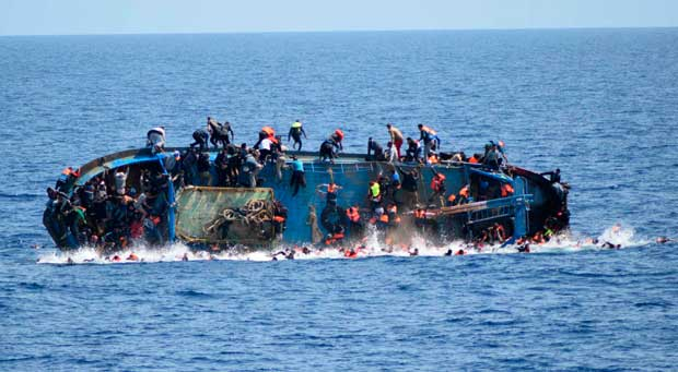"TOPSHOT - This handout picture released on May 25, 2016 by the Italian Navy (Marina Militare) shows the shipwreck of an overcrowded boat of migrants off the Libyan coast today. At least seven migrants have drowned after the heavily overcrowded boat they were sailing on overturned, the Italian navy said. The navy said 500 people had been pulled to safety and seven bodies recovered, but rescue operations were continuing and the death toll could rise. The navy's Bettica patrol boat spotted ""a boat in precarious conditions off the coast of Libya with numerous migrants aboard,"" it said in a statement. / AFP PHOTO / MARINA MILITARE AND AFP PHOTO / STR / RESTRICTED TO EDITORIAL USE - MANDATORY CREDIT ""AFP PHOTO / MARINA MILITARE"" - NO MARKETING NO ADVERTISING CAMPAIGNS - DISTRIBUTED AS A SERVICE TO CLIENTS"